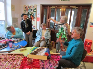 Members of the Craft group discuss their work