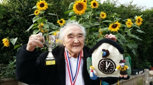 Edna Rose, overall winner of Bramley Challenge 2015, with her fabulous knitted cuckoo clock.