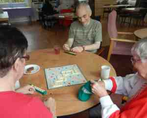 Playing Scrabble at games afternoon