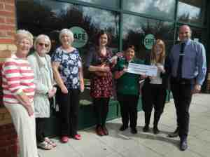 Fran Graham receives the cheque from Morrisons Community Champion Alicia Nash and store manager David Harrison