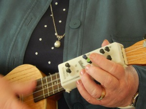 Participant at ukulele group using a chord changer